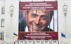 A banner depicting former Italian prime minister Silvio Berlusconi smiling out from behind superimposed prison bars hangs on the facade of Kharkiv's Parliament. Officials in a Ukrainian city responded in kind after authorities in Italy dangled a large portrait of Ukraine's jailed former leader Yulia Tymoshenko outside Rome's city hall.  Picture: SERGEY BOBOK/AFP/Getty Images