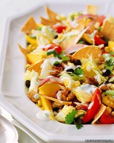 Taco salad has a reputation as being high in fat and calories, but this rethink improves the score on both counts. Ground turkey takes the place of beef, while nonfat yogurt mixed with lime juice, jalapeno, and cilantro makes a creamy dressing. Toast your own corn tortilla wedges to use instead of oily chips.  Get the Taco Salad Recipe
