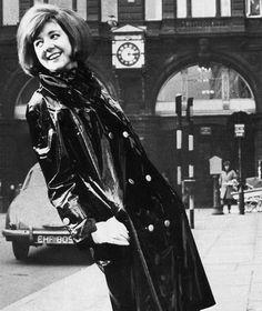 Cilla Black wearing shiny black plastic mac and boots - February 1964 Vinyl Raincoat, Pvc Raincoat, Plastic Raincoat, Mod Fashion, 1960s Fashion, Miss You Girl, Coloured Leather Jacket, Latex, Cilla Black