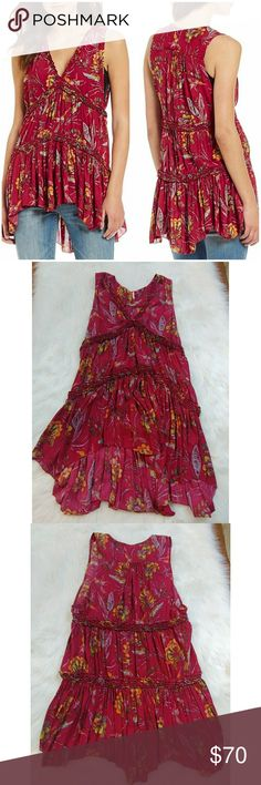 """Free People Tunic Large Purple Haze Raspberry NWOT Free People Purple Haze Tunic Raspberry Size Large. Beautiful Floral & Hummingbird Print. Cheeky on the sleeves, styled to show whatever cami you pair with it: large arm openings. High Low Style. No Trades.   Fabric is polyester  Measurements are below, taken straight across with the Garment laying flat  Bust- 17 stretched to 21"""" Length - 30/37 0083709175tg Free People Tops Tunics"""