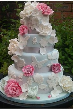 A gorgeous flowers and butterfly covered spring/garden wedding cake. #food #wedding #cake #butterflies #roses