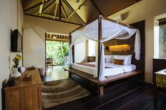Stunning four poster beds, high ceilings and private verandahs are key features of Belong Dua bedrooms.