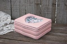 Shabby chic jewelry box. Hand painted in delicate pink with decoupage of pink and teal, lightly distressed, and finally hand waxed. The top opens to a forest green velveteen interior and a lift out tr