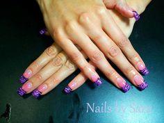 Purple glitter, acrylic nails, zebra stripes.