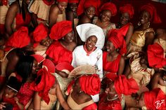 Bride surrounded by her friends at her traditional marriage ceremony #yoruba #asoebi #coralbeads #asooke #traditionalwedding #traditionalrites #asoebibella #inkheartsbride #inkhearts