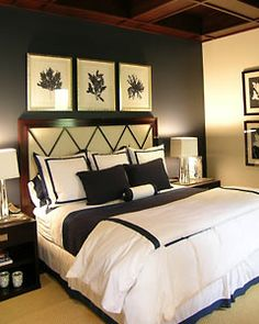 This bedroom in Dallas, Texas is both simple and elegant. The navy blue is off-set by the bright white of the bed linens, and the contrast of the dark and light, along with the dark navy on just the wall behind the bed, makes the room appear spacious and clean.