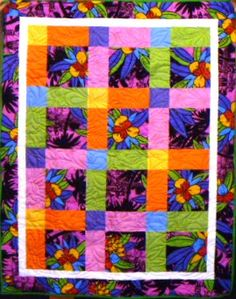 A bright kit quilt, glowing with summer sunshine.