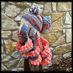 Octopus hat crocheted in blues and corals and beiges.