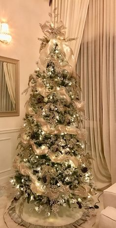 Beautifully decorated 9ft Flocked Pine Christmas tree