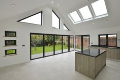 a large extension to a bungalow, to accommodate an open plan kitchen and entertaining space. Bespoke aluminium windows were used to maximize light and to frame views onto the garden Bungalow Extensions, Garden Room Extensions, House Extensions, House Extension Plans, House Extension Design, Rear Extension, Extension Ideas, Roof Design, House Design