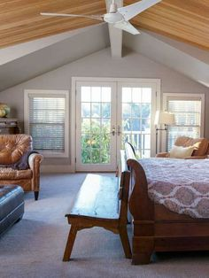 Who wouldn't want master bedroom with a cathedral ceiling and French doors that open onto a wisteria-bedecked balcony?   Photo: John Gruen   thisoldhouse.com