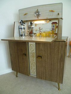 beautiful 50s cocktail bar/LOOKS LIKE MY AUNT MARY'S,SHE DRANK,TOOK UPPERS AND DOWNERS AND WAS THE TYPICAL MOTHER IN THE 60 'S,GLAD SHE WASN'T MY MOM  :) #Homedecorretro