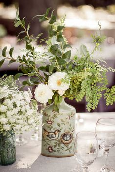 Vintage vase centerpiece (Photo by Oz Visuals; Flowers by Honey and Poppies)