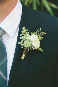Clayton's boutonniere had a mixture of ranunculus, anemone and eucalyptus—an organic arrangement that matched Angela's natural-looking bouquet.