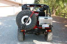 Custom+FJ40+Bumpers | Decker swing out tire carrier and cooler racks. Single latch operation ...