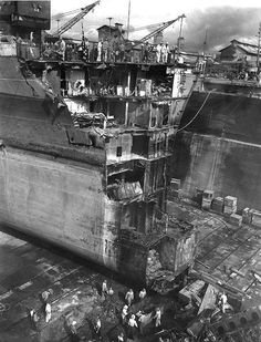 Battleship Washington in drydock at Pearl Harbor Navy Yard to repair collision damage sustained from battleship Indiana in the previous month US Territory of Hawaii March 1944.