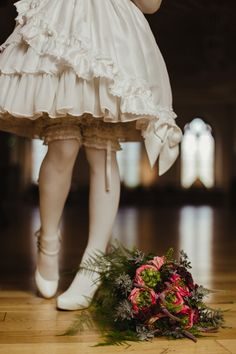 Flower bouquet next to bridesmaid's stocking-clad feet. Photograph by Dublin-based professional wedding photographer Olga Hogan. Get in touch for your own pictures.