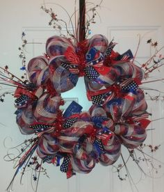 Hooray for the Red, White and Blue!  Reel Sassy Wreath handmade by Sonya Snyder, sbslas@hotmail.com for more info!