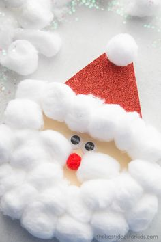 An easy Santa craft for kids. This Santa Claus Craft can also be turned into a card with a free printable Santa template. Christmas Trees For Kids, Christmas Paper, Christmas Activities, Christmas Tree Decorations, Christmas Tree Ornaments, Craft Stick Crafts, Preschool Crafts, Kids Crafts, Crafts Cheap