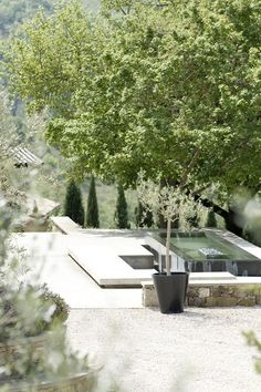 clean pale stone contemporary landscaping and traditional French elements for the garden