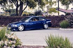 Blue BMW e36 coupe on Borbet type A wheels