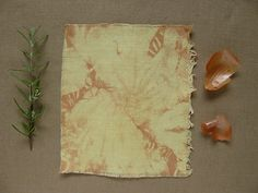 Rosemary dyed fabric mordant alum plus naturally tie and dye - onion skins over dyed with rosemary dyebath. Simmer method