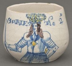 """Caudle cup commemorating King Charles II (r. 1660–85) Probably Southwark, London, England; 1660–85 Earthenware (delftware) Inscribed """"CHARLES The 2D"""""""