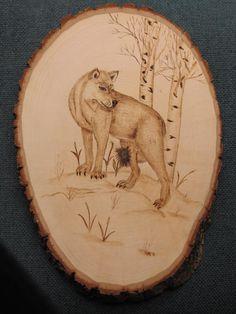 Wolf wood burning.  https://www.facebook.com/?ref=tn_tnmn#!/pages/Austin-Wood-Creations/106083689469233