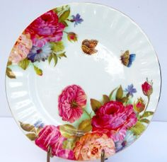 """Sandra's Rose Bone China Chintz 8"""" Salad Plate . $14.95. I just love the feel of bone china, smooth and soft, it speaks quality. This lovely bone china plate features a vivid rose chintz design perfectly set against the white fine bone china background. The edge has a gentle swirl and the plate is rimmed in gleaming gold."""