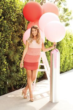 celebrity lauren conrad in a pastel pink ombre dress and giant party balloons. pretty pastels: Soft hues of blue, pink, mint, peach and more delicate sherbet shades are everywhere this Spring season. Pair them with neutrals and whites for a classic feminine look or with metallics for a more trendier vibe.