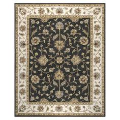 Hand-tufted wool rug with a traditional floral motif.    Product: RugConstruction Material: WoolColor: Black Note: Please be aware that actual colors may vary from those shown on your screen. Accent rugs may also not show the entire pattern that the corresponding area rugs have.