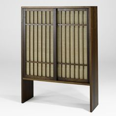 George Nakashima; Walnut and Pandanus Cloth Cabinet, 1966.