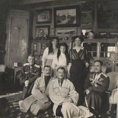 Maria N, Anastasia N and Olga N with officers. Looks like a room in a palace. where? Alexander Palace or Lower Dacha??