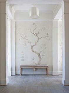 Tone on tone chinoiserie mural on a living room accent wall | The project was handpainted and glazed with Modern Masters Tintable Glaze by the decorative painting firm Billet Collins
