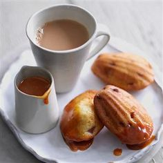 Cherry madeleines with hot rum toffee sauce