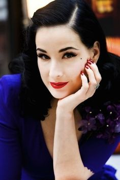 dita-von-teese-profile.jpg (300×450) beautiful royal purple and blue with the classic red. Love.