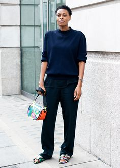 Donna Wallace wearing a navy crew neck sweater and multi-printed sandals