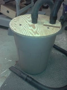 Thein Style Baffle Lid For Use With My Shop Vac. Modify it so that the lid is secured by bolts along the rim of the trashcan.