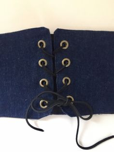 Beautiful recycled reclaimed denim blue jeans made into this chic sexy trendy Kardashian style Corset Belt Waist Cincher Dark denim, 8 brass look grommet eyelets, black leather cord lacing, black fabric lining 34 when cinched tight, adjustable lacing to wear it tight or loose Measures 34 X 5 1/2 Denim shades vary when using recycled reclaimed blue jeans  Quality handcrafted one of a kind Smoke free studio Allow 10 days for delivery