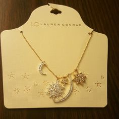 Lauren Conrad Silver and Gold Necklace Beautiful silver and gold tone necklace. *Moon and Stars* Jewelry Necklaces