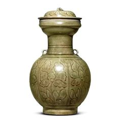 A rare carved Longquan Celadon Vase and Cover, in a crackled olive-green glaze. Northern Song Dynasty, 11th-12th Century. @ Christie's