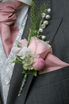 Groom's Boutonniere of a fresh Lily of the Valley, Thalaspi, Champagne Grass, David Austin's Keira Rose, Sweet Peas, Peony and Astrantia
