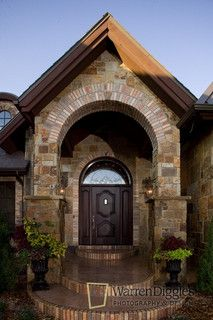 Like the brick with stone above porch & on steps. Like the shape of the columns.