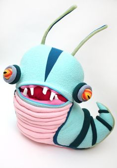 Artist Jennifer Strunge breathes a ghastly new life into discarded garments and fabrics with these extraordinary plush creations called Cotton Monsters.