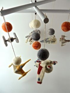 I like this IDEA but not going with Star Wars...  maybe I can find some small cloth superheroes to attach at the bottom & use bold colored craft pompoms...  plastic figurines are all over the place! :/ - STAR WARS 6 Ships Baby Mobile, Customizable Star Wars Mobile, Made to Order