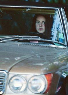 Lana driving a car