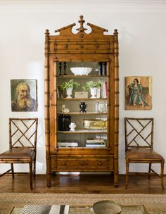 Use art to play with scale. For instance, these Chippendale chairs felt a little squatty when placed alongside this massive antique hutch, so Lauren filled in some of the negative space with canvas oil portraits.