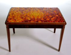 Beautiful 1950's era glossy wood table with glass mosaic top. I'd use it as a desk.
