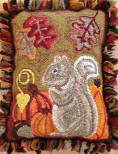 Beehive Rugs: squirrel pillow w/proddy fringe