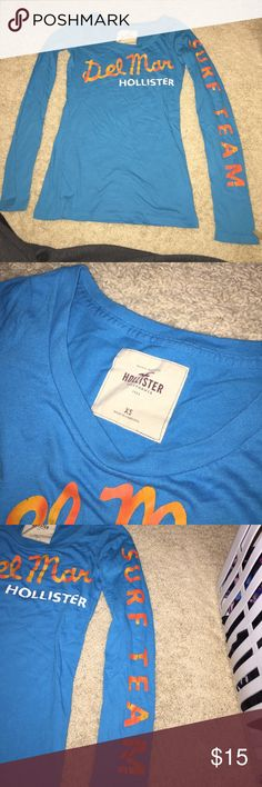"""Hollister long sleeve shirt Blue and orange long sleeve Hollister shirt. """"Del Mar"""" on the front. """"Surf team"""" written down the one sleeve. Perfect condition. Just out grew it. Hollister Tops Tees - Long Sleeve"""